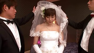 A Japanese bride wears her nuptial gown while bouncing on a unearth