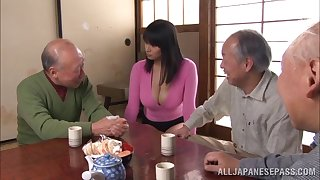 Bosomy Japanese babe exposes her muff to the venerable men to tease redness with a vibrator