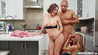 Interracial threesome sex at the kitchen