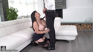 Busty Asian brunette Tigerr Benson gives a titjob and gets fucked
