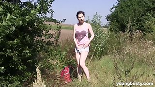 Dirty solo slut Daphne drops her garments to masturbate in outdoors