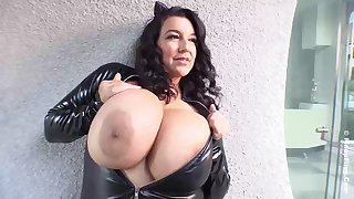 Busty dour in a tight, latex costume, Subrina Lucia is showing us her massive milk breast