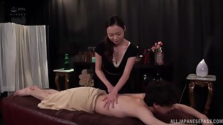 Passionate lovemaking on the kneading bounds with a Japanese darling
