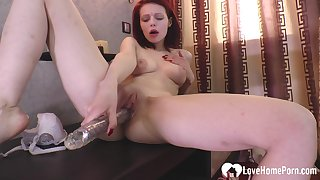 Hot redhead girlfriend teasing with a sex toy